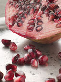 Halved Pomegranate With Seeds — Stock Photo