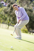 Woman Playing A Game Of Golf — Stok fotoğraf