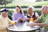 Friends Enjoying A Beverage By A Golf Course — Stock Photo