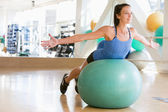 Woman Balancing On Swiss Ball — Stock Photo