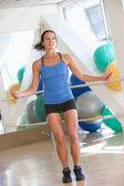 Woman Using Skipping Rope At Gym — Stock Photo