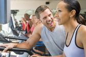 Personal Trainer Encouraging Woman Using Treadmill At Gym — Stock Photo