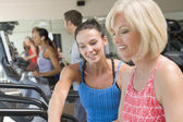 Personal Trainer Showing Woman How To Use Treadmill — Stock Photo