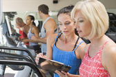 Personal Trainer Instructing Woman On Treadmill — Stock Photo