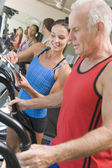 Personal Trainer Instructing Man On Treadmill — Stock Photo
