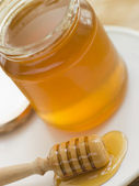 Jar Of Honey And Spoon — Stock Photo