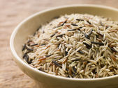 Bowl Of Uncooked Wild, Basmati And Red Carmague Rice — Stock Photo