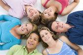 Teenagers Lying Down Head To Head — Stock Photo