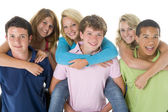 Teenage Girls Piggy Back On Boys — Stock Photo