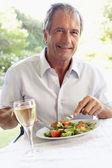 Senior Man Eating An Al Fresco Lunch — Stock Photo