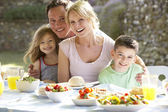 Family Eating An Al Fresco Meal — Stock Photo