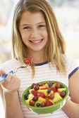 Young Girl Eating Fresh Fruit Salad — Stock Photo