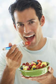 Mid Adult Man Eating Fresh Fruit Salad — Stock Photo