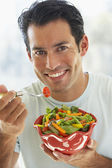 Mid Adult Man Eating Salad — Stock Photo