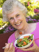 Senior Woman Eating Fresh Salad — Foto de Stock