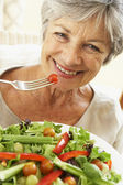 Senior Woman Eating Healthy Salad — Stock Photo