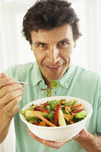Mid Adult Man Eating A Healthy Salad — Stock Photo