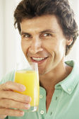 Mid Adult Man Drinking A Glass Of Orange Juice — Stock Photo