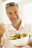 Middle Aged Man Eating A Healthy Salad — Stock Photo