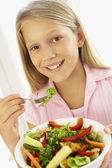 Young Girl Eating Fresh Salad — Stock Photo