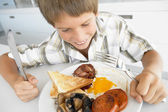 Young Boy Eating Unhealthy Fried Breakfast — Stock Photo
