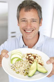 Mid Adult Man Holding Plate Of Healthy Food — Stock Photo