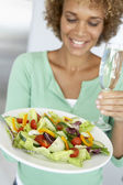Mid Adult Woman Holding A Wine Glass And Fresh Salad — Stock Photo