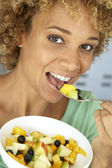 Mid Adult Woman Eating Fresh Fruit Salad — Stock Photo