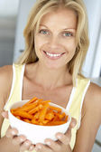 Mid Adult Woman Holding A Bowl Of Carrots — Stock Photo