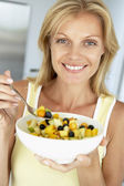 Mid Adult Woman Eating A Bowl Of Fresh Fruit — Stock Photo