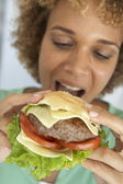 Mid Adult Woman Eating A Burger — Stock Photo