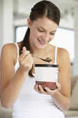 Young Woman Eating Chocolate Ice-Cream — Stock Photo