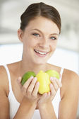 Young Woman Holding Fresh Fruit And Smiling At The Camera — Stock Photo