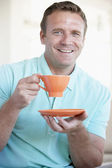 Mid Adult Man Holding Orange Mug And Smiling At The Camera — Stock Photo
