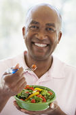 Middle Aged Man Eating Salad — Stock Photo