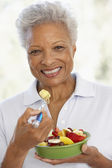 Senior Adult Eating A Fresh Fruit Salad — Stock Photo