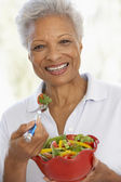 Senior Woman Eating A Fresh Green Salad — Stock Photo