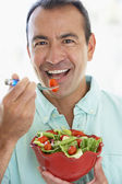 Middle Aged Man Eating A Fresh Green Salad — Stock Photo