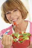 Middle Aged Woman Eating A Fresh Green Salad — Stock Photo