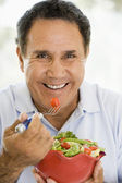 Senior Man Eating A Fresh Green Salad — Stock Photo