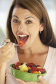 Mid Adult Woman Eating A Fresh Fruit Salad — Stok fotoğraf