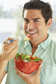 Mid Adult Man Holding A Bowl Of Salad, Smiling At The Camera — Stock Photo