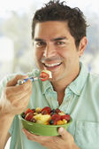 Mid Adult Man Holding A Bowl Of Fresh Fruit Salad Smiling At The — Stock Photo