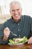 Senior Man Eating A Healthy Meal — Stock Photo