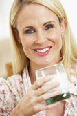 Mid Adult Woman Holding Glass Of Milk, Smiling At Camera — Stock Photo