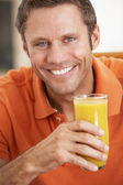Middle Aged Man Drinking Fresh Orange Juice — Stock Photo