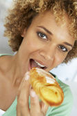 Mid Adult Woman Eating A Pastry — Stock Photo