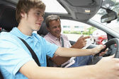 Teenage Boy Taking A Driving Lesson — Stockfoto