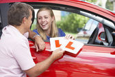 Teenage Girl Receiving Her Learner Plates — Stock Photo