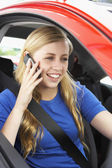 Teenage Girl Sitting In Car Talking On Cellphone — Stock Photo